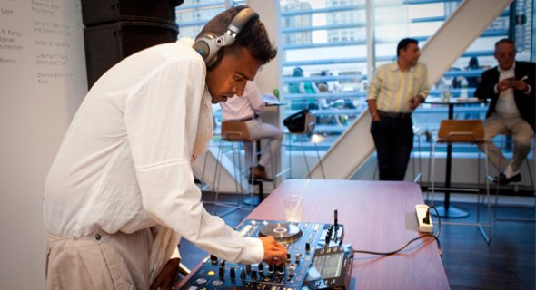 DJ RuBot mixes during happy hour before the evening's performance. Photo by Chasi Annexy.