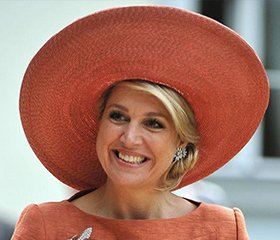 Queen Maxima of the Netherlands wearing a wide-brimmed hat
